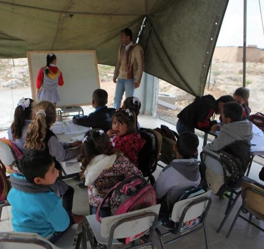 Palestinian students have their lessons inside a tent after Israeli forces demolished a primary school in Hebron, West Bank