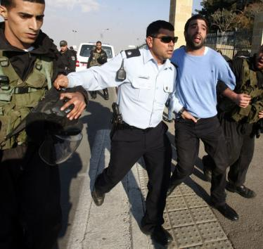 Israeli forces arrest a Palestinian at Hebrew University during a protest against Israel's attack on Gaza, 20 November 2012
